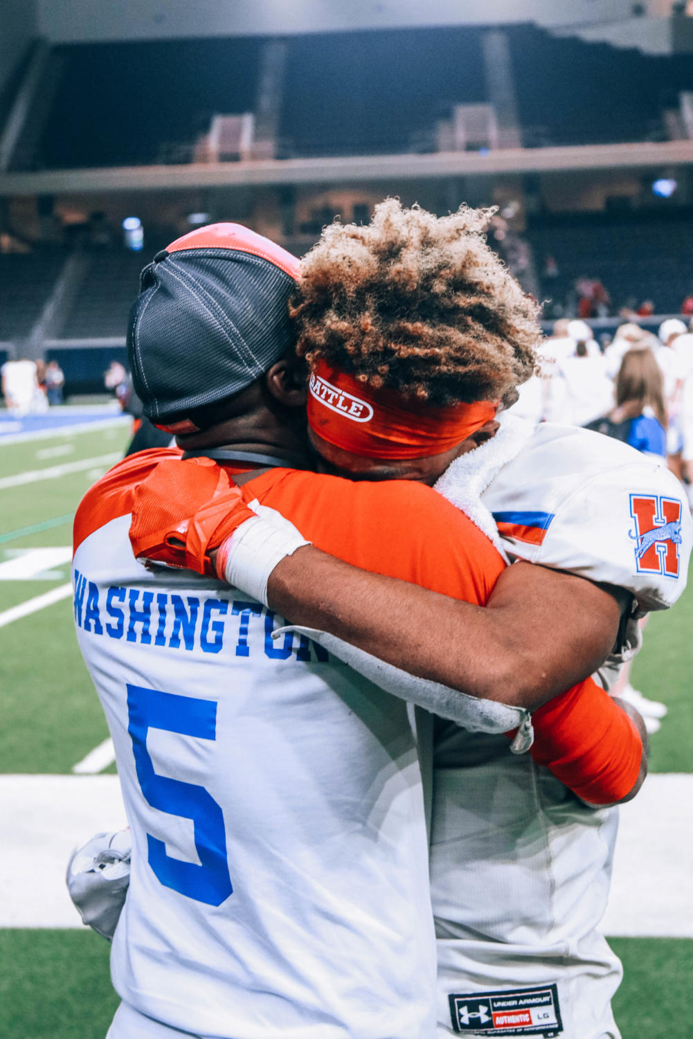 Dre+Washington+%2812%29+hugs+his+dad+after+the+devastating+loss+against+Carthage.+%E2%80%9CI+left+everything+I+had+on+the+field%2C%E2%80%9D+Washington+said.+Washington+didn%27t+feel+the+need+to+cry+because+he+knew+that+he+tried+his+best.+%0A